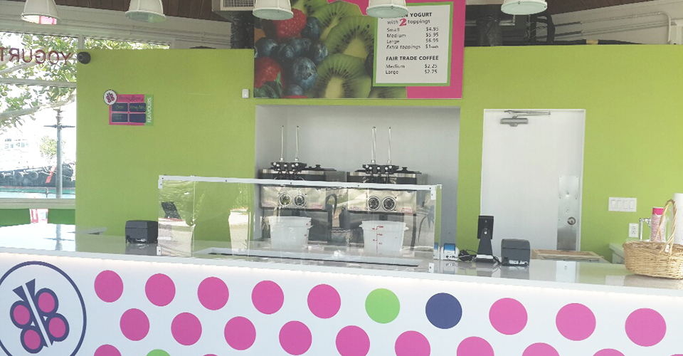 Polka dotted counter with a butterfly logo and bright green and pink colors